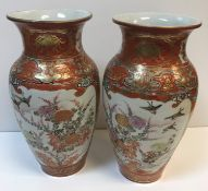 A pair of 19th Century Chinese Kutani ware vases decorated with panels of birds, blossom and figures