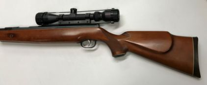 A Weihrauch HW77K .22 air rifle (No. 1018305), together with Tasco 7 x 32 telescopic sight, together