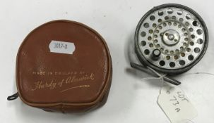 """A Hardy """"The L.R.H. Lightweight"""" 3 1/8"""" diameter fly reel, together with maker's leather pouch"""