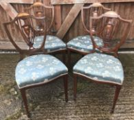 A set of four Edwardian mahogany and inlaid shield back salon chairs by Blyth & Sons of 4 Chiswell