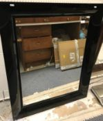 A Kartell black PVC framed Francois Ghost mirror with plain rectangular plate, designed by