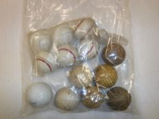 A collection of six Align Purestrike ridged golf balls together with a leather covered golf ball and