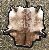 A modern Impala pelt rug with black felt backing, approx 208 cm x 134 cm