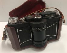 A Panon Widelux F7 Panoramic camera, No'd. 348085, housed in brown leather caseCondition