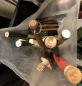 A bag containing various sporting items including hockey sticks, cricket bat, tennis rackets,
