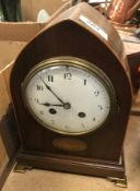 An Edwardian mahogany inlaid mantel clock of lancet form, 25 cm high, together with a German 365 day