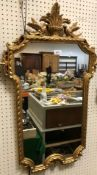 Two modern gilt framed mirrors, one of oval form with floral decoration, 56 cm x 46.5 cm, the
