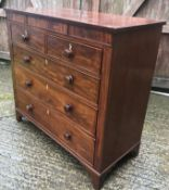 A Victorian mahogany chest of drawers, the plain top over two short and three long drawers to