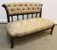 A Victorian canape (settee) with gold self patterned floral upholstery, 104 cm wide x 83 cm deep x