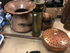 A large Middle Eastern style two handled copper pot with flared rim 28.5 cm high, a brass shell case