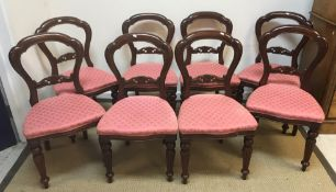 A set of eight Lion House Antiques Victorian style mahogany dining chairs with upholstered seats