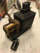 """A Victorian magic lantern housed in a metal carrying case with lens inscribed """"Aldis-Butcher"""