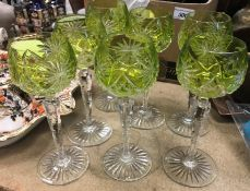 A set of seven green cut glass hock glasses, 19.5 cm high