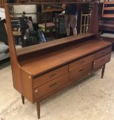 A G Plan teak dressing chest with mirrored superstructure over a bank of six drawers on turned