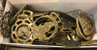 A collection of approx. thirty-eight horse brasses bearing various decoration