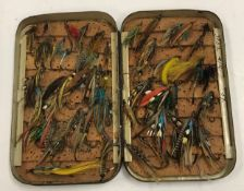 A japanned salmon fly fishing case with cork liners, containing approx 50 fully dressed salmon