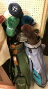 Two golf bags and contents of Hippo, Wilson and other irons, various woods, etc (30 total)