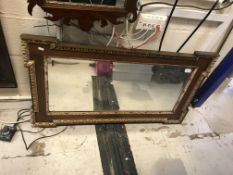 A mahogany and gilt framed rectangular wall mirror in the Georgian style with egg and dart