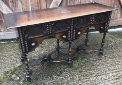 An early 20th Century oak side table in the 17th Century manner, the quarter cut oak top with