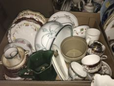 Two boxes of assorted decorative china wares to include various decorative plates, chamber pot, etc