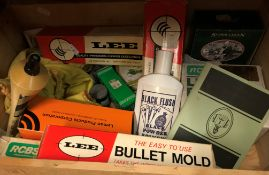 Two boxes of various ammunition making and cleaning equipment including patches and other cleaning