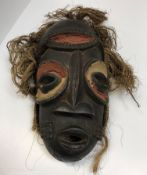 An African tribal mask with painted and carved dec