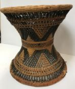 A tribal canework waisted stool, cowrie shell and