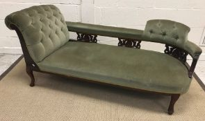 A late Victorian mahogany framed chaise longue with carved gallery back and buttoned upholstery on