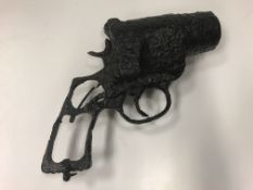 A World War I flare gun, possibly Webley & Scott, very corroded/non-functioning 21 cm in length