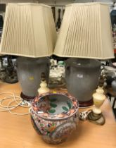 A pair of modern Chinese grey crackleware glazed vase style table lamps on stained beech turned