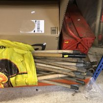 A bundle of drain rods, cantilever tool box, four petrol engined model stunt planes, jam pan,