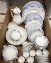 A Royal Worcester Petite Fleur blue smooth dinner service comprising eleven plates,
