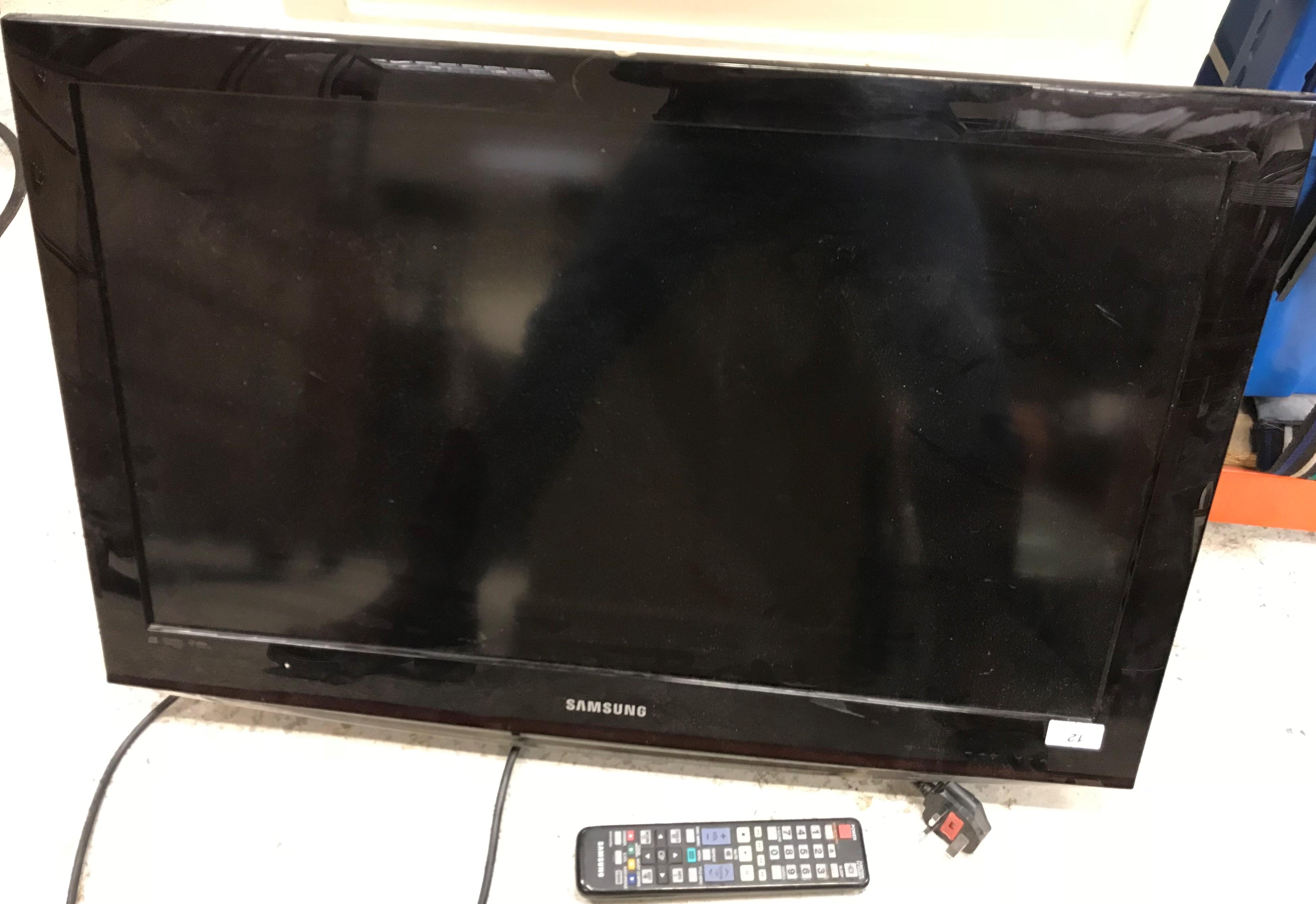 A Samsung model LE32C450E1W colour television with remote control
