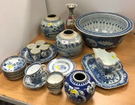 A collection of Chinese pottery and porcelain to include a blue and white sauceboat decorated with