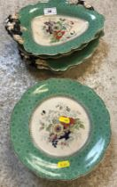 A Victorian ironstone dessert service, with underglazed transfer decoration and green banded border,