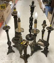 A collection of eight various table lights including two faux candlestands on dragon decorated