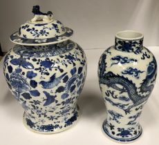 A circa 1900 Chinese blue and white baluster shaped vase decorated with four toed dragons chasing a