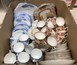 A box of various tea wares to include Sutherland China blue floral decorated tea set,