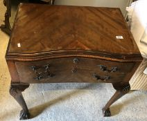 A 1930's mahogany and inlaid inverted serpentine fronted two drawer canteen table on shell carved