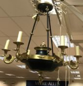 A brass and black painted metal six branch electrolier in the Empire style with swan decoration to