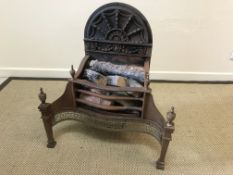 A 20th Century steel and cast iron fire basket in the Regency taste with integral fan decorated back