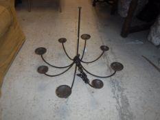 A 20th Century wrought iron eight branch chandelier, 79 cm diameter x 65 cm drop
