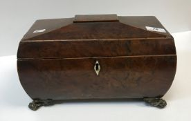 A 19th Century burr yew tea caddy of sarcophagus form, the top opening to reveal a central mixing