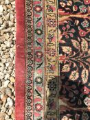 A Tabriz type carpet, the central panel set with foliate and bird decoration and central vase of