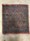A Caucasian rug, the central panel set with all-over scrolling foliate design on a dusky pink