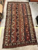 A Kasak carpet, the central panel set with striped design on a red and blue and cream background,