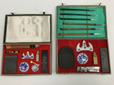 A modern Chinese calligraphy set with six brush pens, ink stone, pen rests, seal, etc, in fabric
