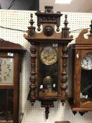A 19th Century walnut cased Vienna regulator, the