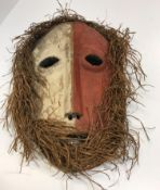 An African tribal mask with red and white painted