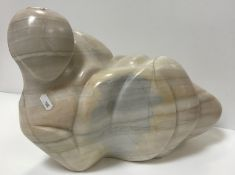A modern carved marble figure of a recumbent nude,